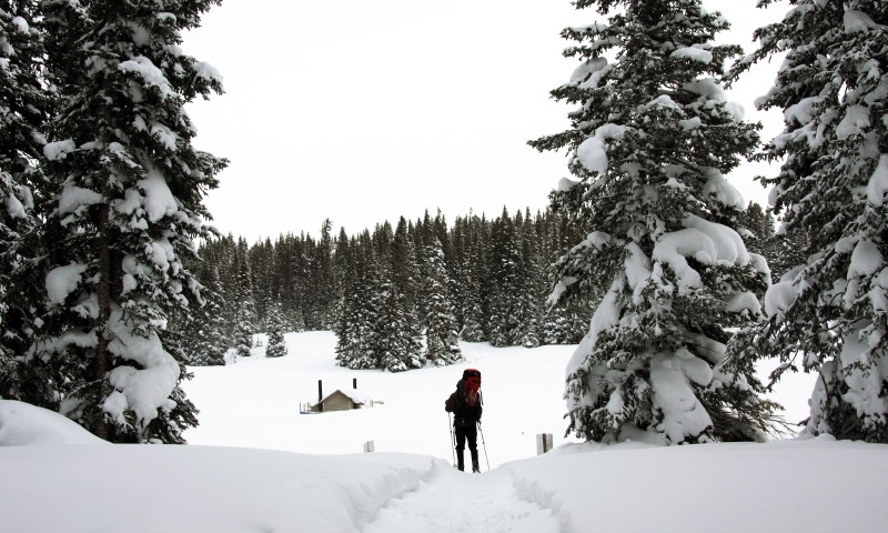 Skier approaches Hut on Vail Pass