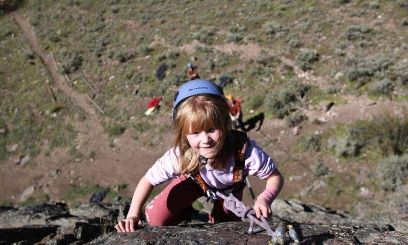 Kid climbing with Apex Mountain School